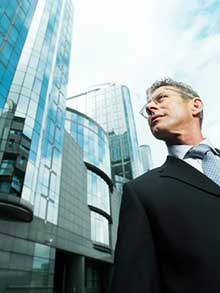 man looking at office building